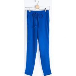Spodnie dresowe damskie: Kobaltowe Spodnie Dresowe Hot Girl