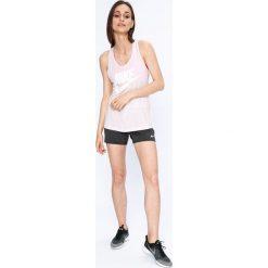 Nike Sportswear - Top. Szare topy sportowe damskie marki Nike Sportswear, l, z nadrukiem, z dzianiny, z okrągłym kołnierzem. W wyprzedaży za 79,90 zł.