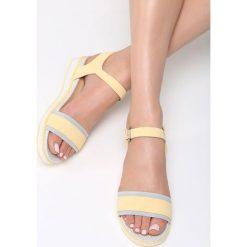 Żółte Sandały Halcyon Days. Żółte sandały damskie marki Born2be, z materiału, na obcasie. Za 79,99 zł.