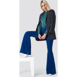 Jeansy damskie: Trendyol Jeansy dzwony - Blue