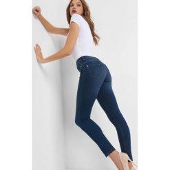 Jegginsy push-up. Czarne legginsy we wzory marki Orsay, xs, z bawełny, z dekoltem na plecach. Za 79,99 zł.