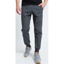 Spodnie dresowe męskie: Spodnie dresowe męskie SPMD301 - ciemny szary melanż