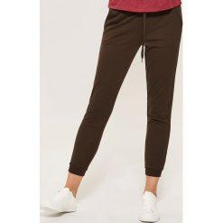 Dresowe joggery - Khaki. Brązowe spodnie dresowe damskie House, l, z dresówki. Za 59,99 zł.