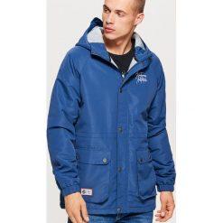 Casualowa kurtka z kapturem - Niebieski. Niebieskie kurtki męskie marki Cropp, l, z kapturem. W wyprzedaży za 149,99 zł.