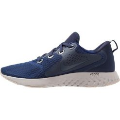 Nike Performance LEGEND REACT Obuwie do biegania treningowe blue void/thunder blue/obsidian/diffused taupe/moon particle. Niebieskie buty do biegania męskie Nike Performance, z materiału. Za 419,00 zł.