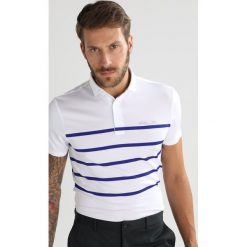Polo Ralph Lauren Golf PRO FIT Koszulka sportowa pure white/city. Białe koszulki do golfa męskie Polo Ralph Lauren Golf, m, z elastanu. W wyprzedaży za 370,30 zł.