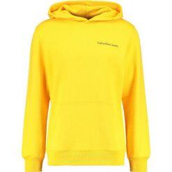 Calvin Klein Jeans HOROS 2 REGULAR POPOVER Bluza z kapturem spectra yellow. Żółte bluzy męskie rozpinane Calvin Klein Jeans, m, z bawełny, z kapturem. Za 499,00 zł.
