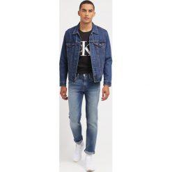 Calvin Klein Jeans Tshirt z nadrukiem meteorite. Czarne koszulki polo marki Calvin Klein Jeans, m, z nadrukiem, z bawełny. W wyprzedaży za 164,25 zł.