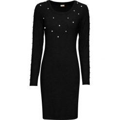 Sukienka dzianinowa z perełkami bonprix czarny. Niebieskie sukienki dzianinowe marki DOMYOS, street, z okrągłym kołnierzem. Za 89,99 zł.