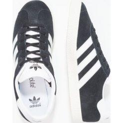 Adidas Originals GAZELLE  Tenisówki i Trampki core black/white/gold metallic. Czarne trampki chłopięce marki adidas Originals, z materiału. Za 249,00 zł.