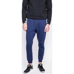 Nike Sportswear - Spodnie. Niebieskie joggery męskie marki Nike Sportswear, z bawełny. W wyprzedaży za 199,90 zł.