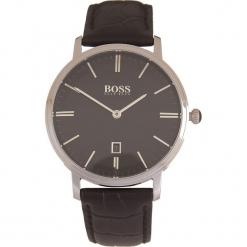 Zegarek kwarcowy w kolorze czarno-srebrnym. Czarne, analogowe zegarki męskie marki HUGO BOSS, ze stali. W wyprzedaży za 521,95 zł.