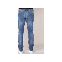 Jeansy slim fit Diesel  THOMMER. Niebieskie jeansy męskie relaxed fit marki Diesel. Za 559,20 zł.