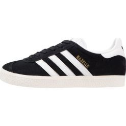 Adidas Originals GAZELLE Tenisówki i Trampki core black/white/gold metallic. Czarne tenisówki damskie adidas Originals, z materiału. W wyprzedaży za 359,10 zł.