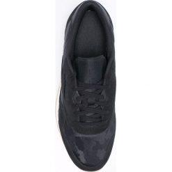 Reebok Classic - Buty BS9569. Czarne halówki męskie marki Asics, do piłki nożnej. W wyprzedaży za 199,90 zł.