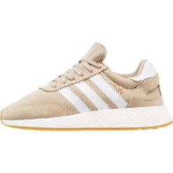 Adidas Originals I5923 Tenisówki i Trampki raw gold/footwear white. Szare tenisówki damskie marki adidas Originals, z gumy. W wyprzedaży za 356,85 zł.