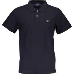 Koszulka polo w kolorze ciemnoniebieskim. Niebieskie koszulki polo marki GANT, xs, polo, z krótkim rękawem. W wyprzedaży za 209,95 zł.