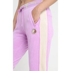 Fenty PUMA by Rihanna FITTED TRACK PANT Spodnie treningowe violet. Fioletowe bryczesy damskie Fenty PUMA by Rihanna, m, z bawełny. Za 719,00 zł.