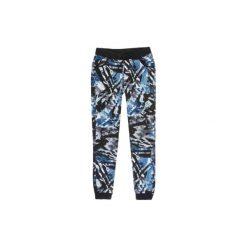 Spodnie damskie dresowe ze ściągaczami we wzory. Szare spodnie dresowe damskie marki TXM, z dresówki. Za 24,99 zł.