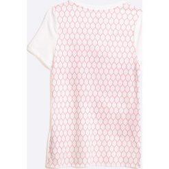 Nike Kids - Top dziecięcy 122-156 cm. Różowe bluzki dziewczęce marki Mayoral, z bawełny, z okrągłym kołnierzem. W wyprzedaży za 49,90 zł.
