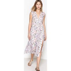 Sukienki hiszpanki: Rozszerzana sukienka w kwiaty z długim rękawem
