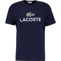 Lacoste Tshirt z nadrukiem marine. Szare t-shirty męskie z nadrukiem marki Lacoste, z bawełny. Za 219,00 zł.