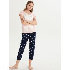 Dwuczęściowa piżama z misiem - Różowy. Czerwone piżamy damskie marki DOMYOS, z elastanu. Za 59,99 zł.