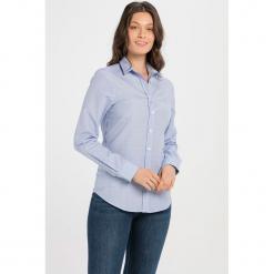Koszula w kolorze jasnoniebieskim. Niebieskie koszule damskie Jimmy Sanders, l, z klasycznym kołnierzykiem. W wyprzedaży za 82,95 zł.
