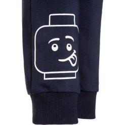 Chinosy chłopięce: LEGO Wear ICONIC PING 102 PANTS Spodnie treningowe dark navy