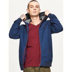 Lekka kurtka z kapturem - Granatowy. Niebieskie kurtki męskie marki QUECHUA, m, z elastanu. W wyprzedaży za 49,99 zł.