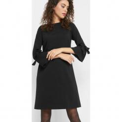 Trapezowa sukienka. Brązowe sukienki dzianinowe marki Orsay, s. Za 99,99 zł.
