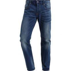 Scotch & Soda VERNON KIMONO YES Jeansy Slim Fit kimono yes. Niebieskie jeansy męskie relaxed fit Scotch & Soda, z bawełny. W wyprzedaży za 377,10 zł.