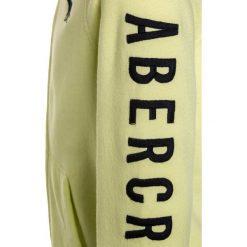 Abercrombie & Fitch LOGO CORE  Bluza rozpinana yellow. Żółte bluzy chłopięce rozpinane Abercrombie & Fitch, z bawełny. W wyprzedaży za 152,10 zł.