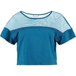 Reebok Koszulka sportowa turquoise. Niebieskie t-shirty damskie marki Reebok, xl, z elastanu. W wyprzedaży za 125,30 zł.