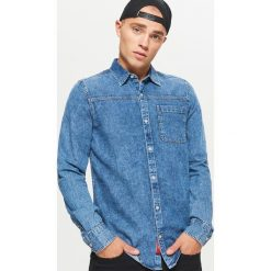 Denimowa koszula - Niebieski. Niebieskie koszule męskie na spinki Cropp, l. W wyprzedaży za 39,99 zł.