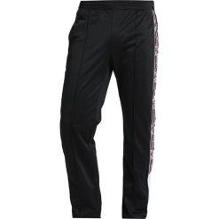Champion Reverse Weave SPECIAL SEMI DULL Spodnie treningowe black. Czarne spodnie dresowe męskie Champion Reverse Weave, z dresówki. Za 359,00 zł.