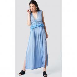 Trendyol Sukienka maxi z rozcięciami - Blue. Szare długie sukienki marki Trendyol, na co dzień, z elastanu, casualowe, dopasowane. Za 141,95 zł.