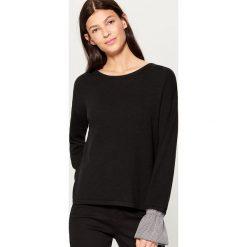 Sweter z koszulowymi rękawami - Czarny. Czarne swetry klasyczne damskie marki Mohito, l, z koszulowym kołnierzykiem. W wyprzedaży za 59,99 zł.