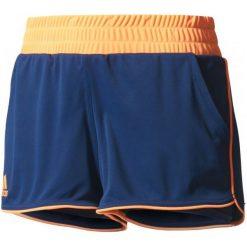 Adidas Spodenki Court Short Mystery Blue /Glow Orange S. Niebieskie spodenki sportowe męskie marki Adidas, ze skóry, sportowe. W wyprzedaży za 109,00 zł.