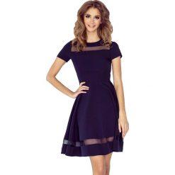 Granatowa Sukienka Rozkloszowana Midi z Tiulowymi Wstawkami. Niebieskie sukienki mini marki Molly.pl, na co dzień, l, z elastanu, eleganckie, z krótkim rękawem, dopasowane. Za 189,90 zł.