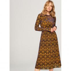 Sukienka midi we wzory - Wielobarwn. Szare sukienki Reserved, l, midi. Za 159,99 zł.