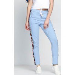 Spodnie damskie: Niebieskie Spodnie Dresowe Party Room