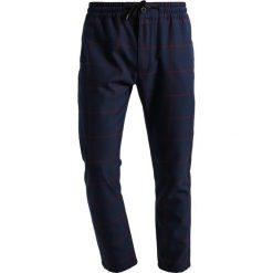 Spodnie dresowe męskie: Topman Spodnie treningowe blue