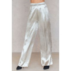 Spodnie damskie: SheIn Metaliczne spodnie z rozszerzanymi nogawkami – Silver