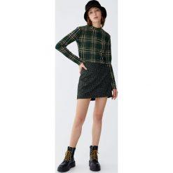 Minispódniczka w zieloną panterkę. Zielone spódniczki Pull&Bear, z motywem zwierzęcym. Za 59,90 zł.