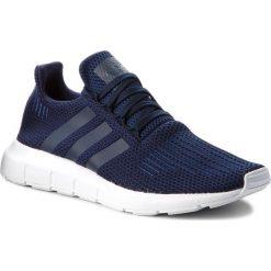 Buty adidas - Swift Run B37727 Conavy/Conavy/Ftwwht. Niebieskie halówki męskie marki Adidas, z materiału. W wyprzedaży za 269,00 zł.
