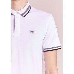 Emporio Armani Koszulka polo bianco ottico. Białe koszulki polo Emporio Armani, m, z bawełny. W wyprzedaży za 367,20 zł.
