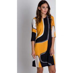 Sukienki hiszpanki: Nowoczesna sukienka we wzory BIALCON