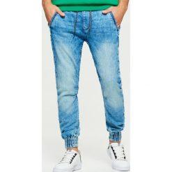 Jeansy SLIM JOGGER - Niebieski. Niebieskie jeansy męskie slim marki QUECHUA, m, z elastanu. Za 129,99 zł.