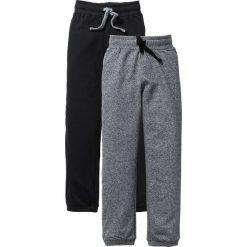 Spodnie dresowe (2 pary) bonprix czarny + szary melanż. Czarne dresy chłopięce marki bonprix, melanż, z dresówki. Za 75,98 zł.